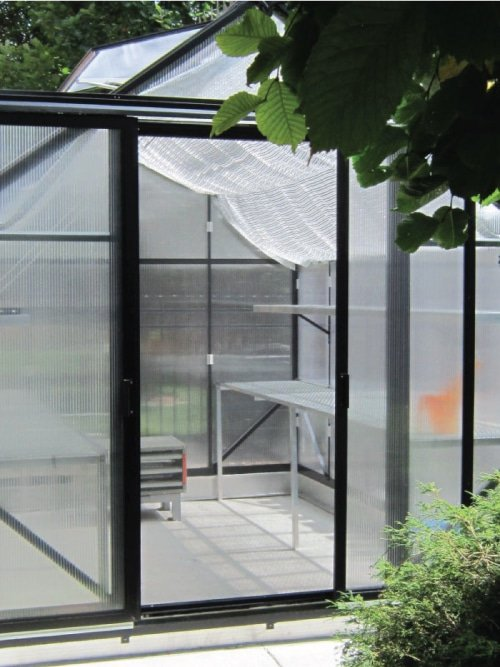 Retractable-Screen-installed-on-greenhouse-to-allow-for-better-climate-control